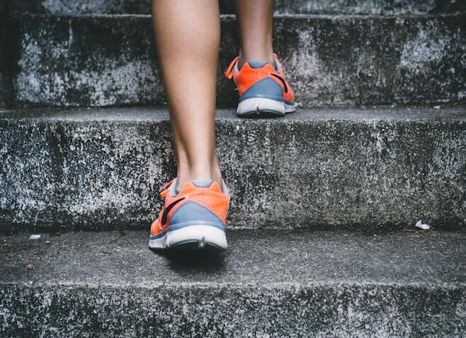 pair of feet jogging up stairs