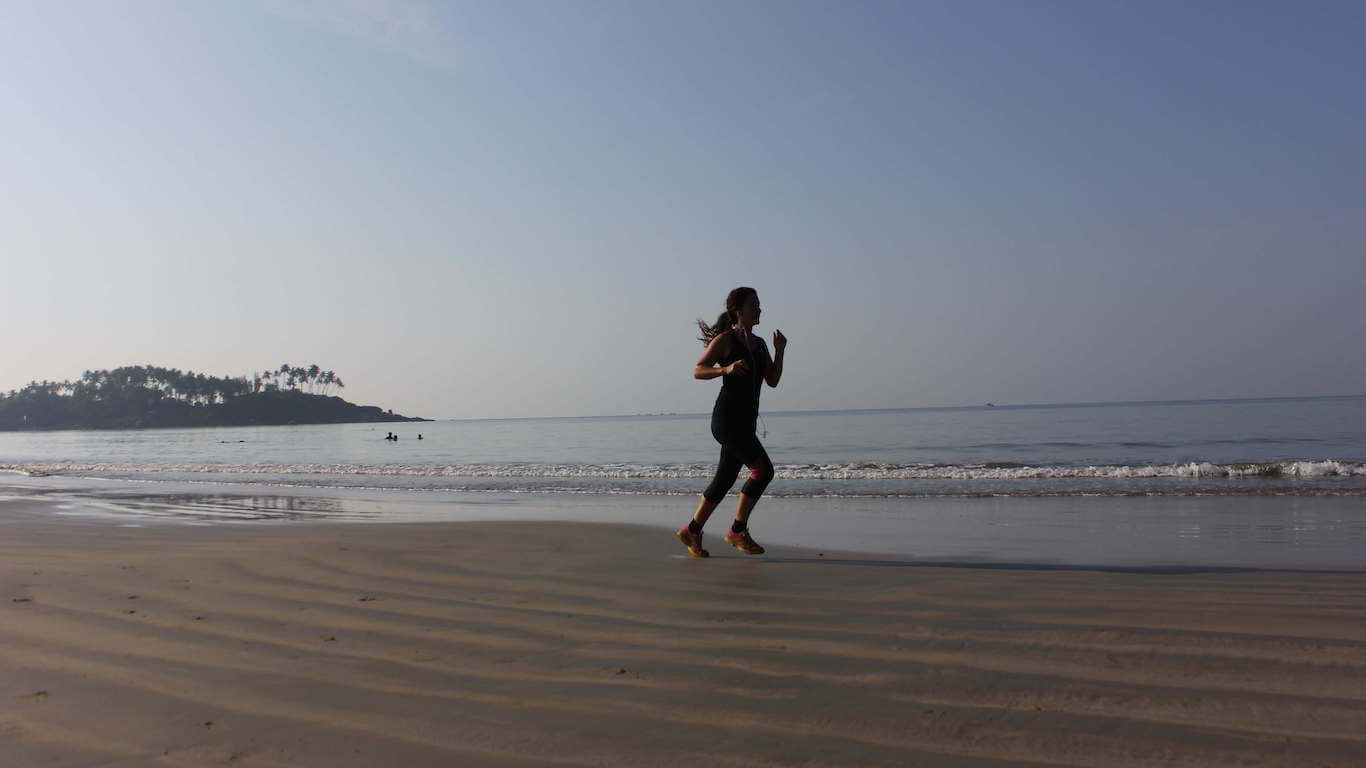 shed pounds this summer - girl running on beach