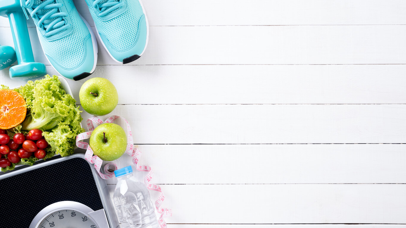 running shoes fruits water and scale